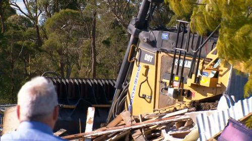 The alleged driver of the bulldozer is also accused of trying to run down a man on the property. (9NEWS)