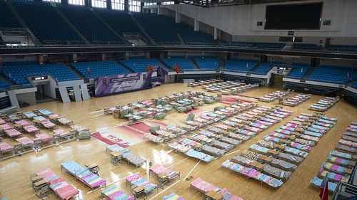 In this photo released by China's Xinhua News Agency, beds are seen in a temporary hospital set up in the Hongshan Gymnasium in Wuhan in central China's Hubei Province.