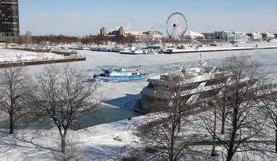 The James Versluis breaks ice on the frozen Chicago River near Navy Pier in Chicago, Illinois.