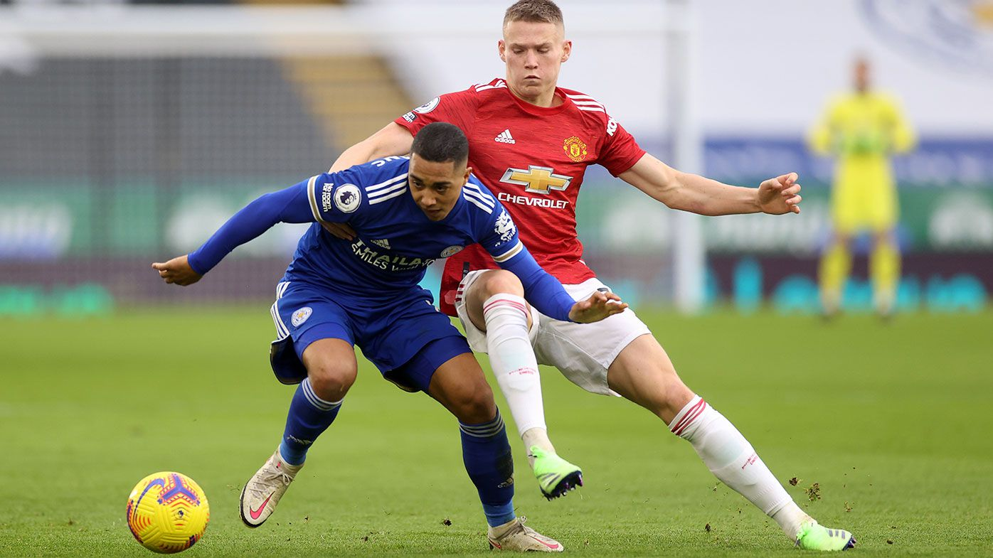 Youri Tielemans of Leicester City is challenged by Scott McTominay of Manchester United.