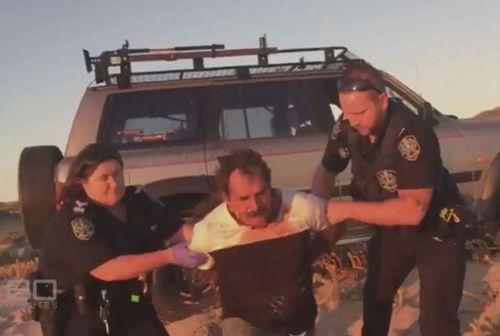 Police arrest a bloodied Heinze. (Supplied: Adam Stewart)