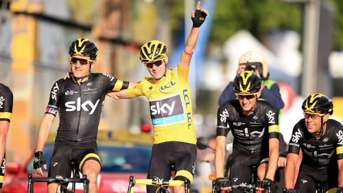 Englishman Chris Froome crosses the finish line of the Tour de France. (AAP)