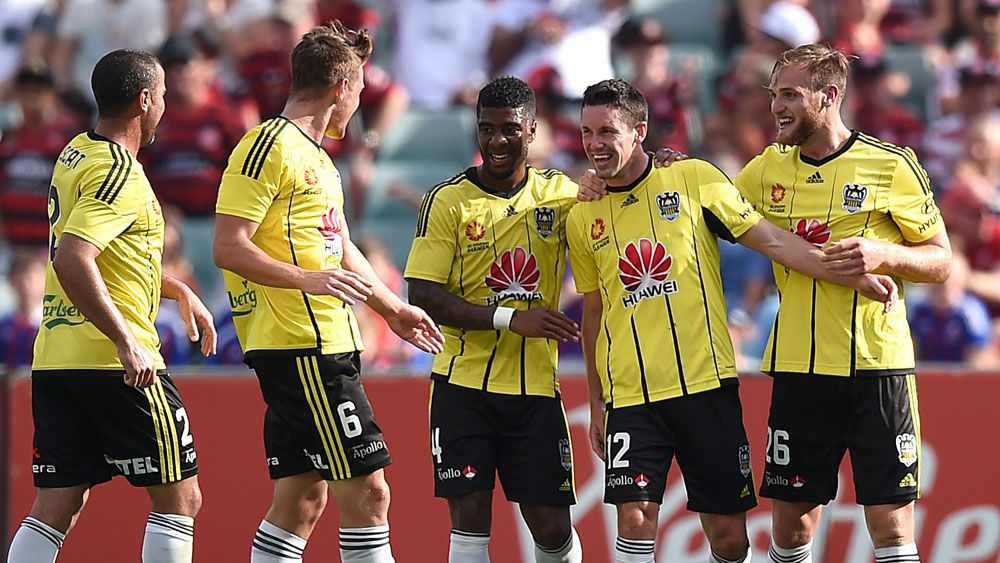 Phoenix players celebrate a goal against the Wanderers. (AAP)