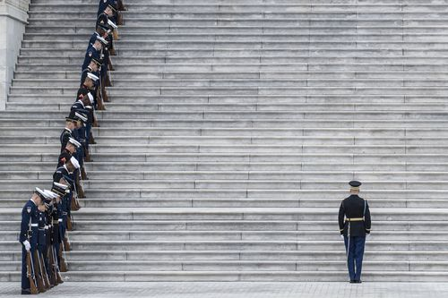 Service members prepare for the remains of President George H.W. Bush to be transported from the U.S. Capitol to the National Cathedral.