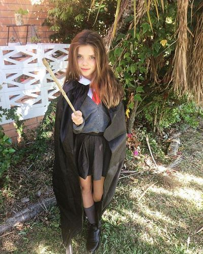 "Hermione Granger from Harry Potter just needs a school uniform and a black cape from <a href=""https://www.thebasewarehouse.com.au/black-cape-89cm.html"" target=""_blank"" draggable=""false"">here</a>."
