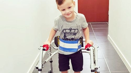 Parents call for change after Australian-born child denied access to disability services