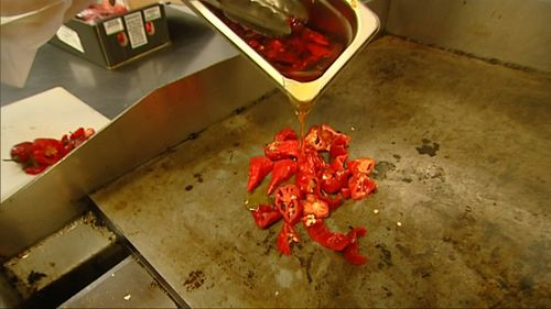 It's so hot, customers have to sign a waiver before they eat it. (9NEWS)