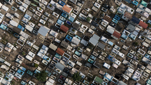 The San Isidro cemetery, that the city's authorities ordered temporarily closed to the public to keep crowds away as a measure to limit the spread of COVID-19 disease, is seen from the air in Mexico City, Sunday, May 10, 2020. (AP Photo/Fernando Llano)