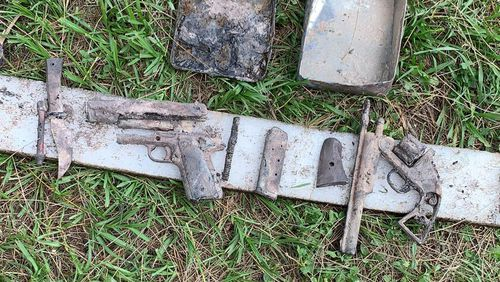 Weapons found in a metal tin during a Clean Up Australia Day event in Brisbane.