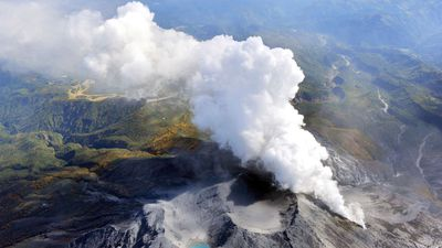 Volcanic gases and ash billow from the peak crater of Mount Ontake. (AP Photo/Kyodo News)