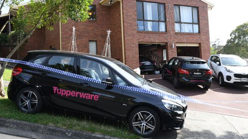 Tupperware vehicles remained parked outside the property. (AAP)