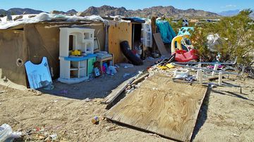 Mounds of trash and human faeces surrounded the desert property. (AP).
