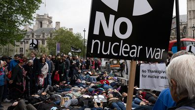 Anti-nuclear activists outside Westminster Abbey where they staged a 'die in' to protest against nuclear weapons.