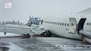 A plane carrying 94 people made an emergency landing in Russia after being hit by a wind shear.