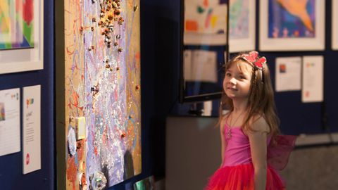 Six-year-old artist Aelita Andre with her piece 'Blue Ocean'