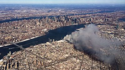 The warehouse fire sends plumes of smoke up into sky over New York. (AAP)