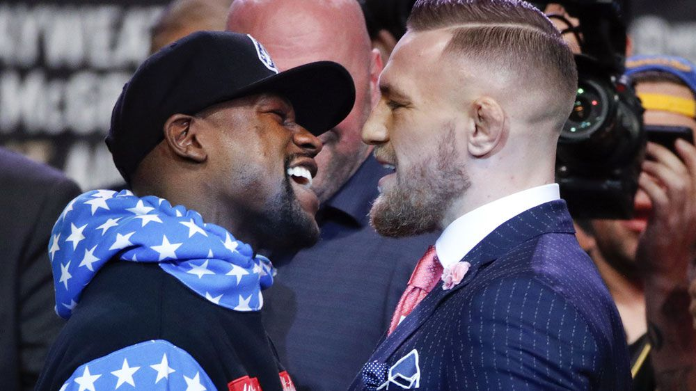 Conor McGregor and Floyd Mayweather meet for the first time at LA press conference