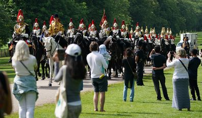 Members of the Household Cavalry make their way down the Long Walk towards Windsor Castle ahead of the ceremony.