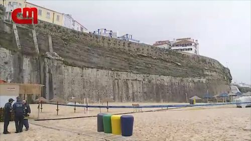 The large stone wall sits 30m above the popular surf beach. (Image: Correio Da Manha)