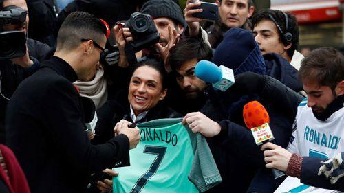 Ronaldo signed autographs for fans as he left court.