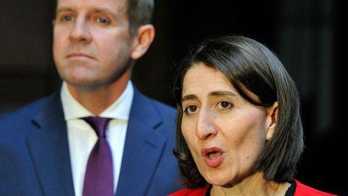NSW Premier Gladys Berejilkian with her predecessor, Mike Baird.
