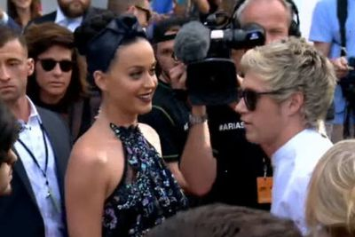 Onlookers were surprised to see Katy dart across the red carpet just for an inside joke and chuckle...<br/><br/>Image: Nine