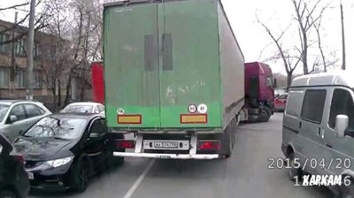 <p>A Russian truckie has given a fellow driver an unwanted towing after accidentally colliding with a car and dragging it down a street.</p><p>  The truckie was negotiating his way through a busy narrow street last Monday when the rear bar of the truck smashed into a traffic-bound car as he rounded a sharp corner. </p><p>  Having unknowingly hooked the car to his semi, the hapless driver could only desperately attempt to accelerate and escape the bar's clutches, but without luck. </p><p>   It is unknown what retribution the truck driver faced, either from the driver or his employer. </p><p>  Check out this gallery for more destructive truckie moments. </p><p></p>