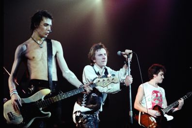 The Sex Pistols - Sid Vicious, Johnny Rotten and Steve Jones performing