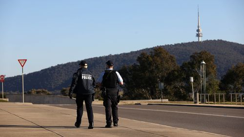 Police patrol around Parliament House in Canberra.