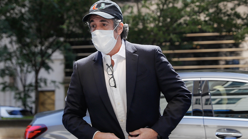 FILE- In this May 21, 2020 file photo, Michael Cohen arrives at his Manhattan apartment in New York after being furloughed from prison because of concerns over the coronavirus.