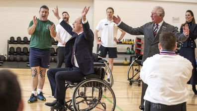 The Duke of Cambridge gets the ball through the hoop while playing wheelchair basket ball during a visit to the Defence Medical Rehabilitation Centre Stanford Hall, Stanford on Soar, Loughborough
