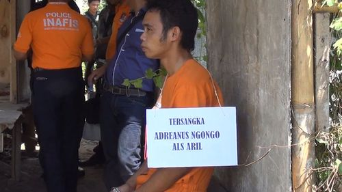 "One of the alleged plotters Adrianus Ngongo alias ""Aril"". All of the group wore orange jumpsuits and signs stating their name during the re-enactment. (9NEWS)"