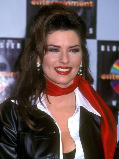 <p>Shania's bold red lip not only matched her accessories but was the perfect beauty look to go with her half-up-half-down hairstyle at the 1996 Country Music Awards.</p>