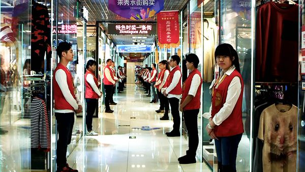 Market salespeople lined up in uniform (Silk Street)