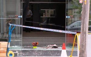 Sydney worker falls through a glass ceiling that shatters on another man