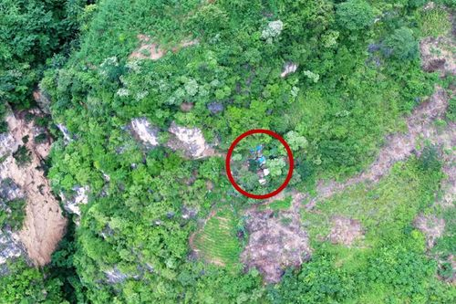 A small blue tile and rubbish outside a secret cave entrance were spotted by a drone, alerting police to Song Jiang's hiding place.