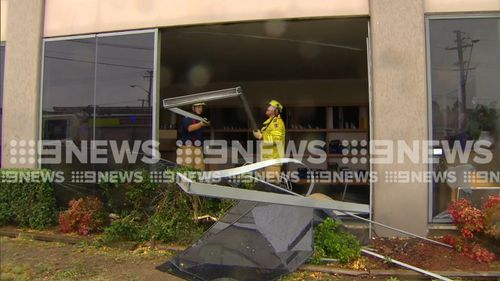 There could have been major structural damage to the shop if the car hit a pillar just centimetres away. (9NEWS)