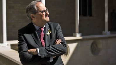 President of the Catalonia regional government, Quim Torra, poses for a photo at the Palau de la Generalitat in Barcelona, Spain. (photo: June 25, 2018)