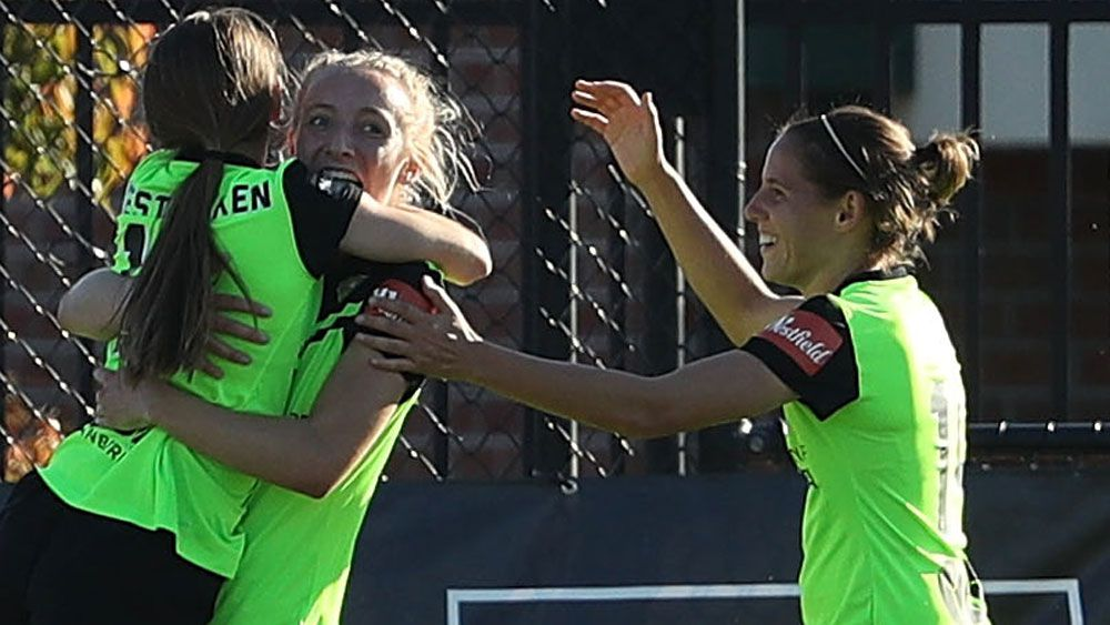 Canberra United players celebrate their win over Melbourne City. (Getty Images)