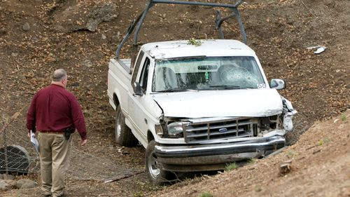 Investigators view a pickup truck involved in a deadly shooting rampage at the Rancho Tehama Reserve. (AAP)