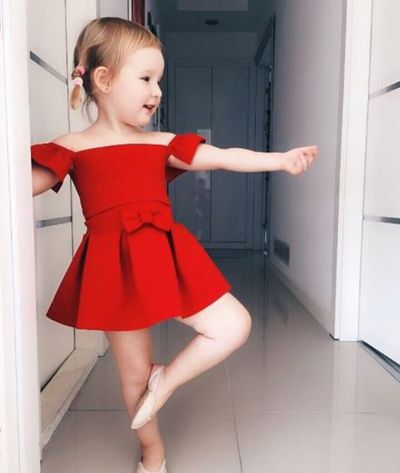 A red party gown is always in style. A big smile too.