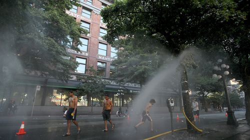 A temporary misting station on Abbott Street during a heatwave in Vancouver, British Columbia.