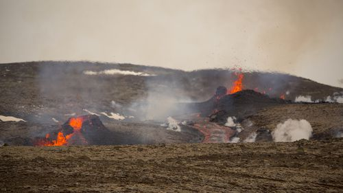 Officials say the new fissure is about 500 meters long and about one kilometre  from the original eruption site in the Geldinga Valley, Iceland.