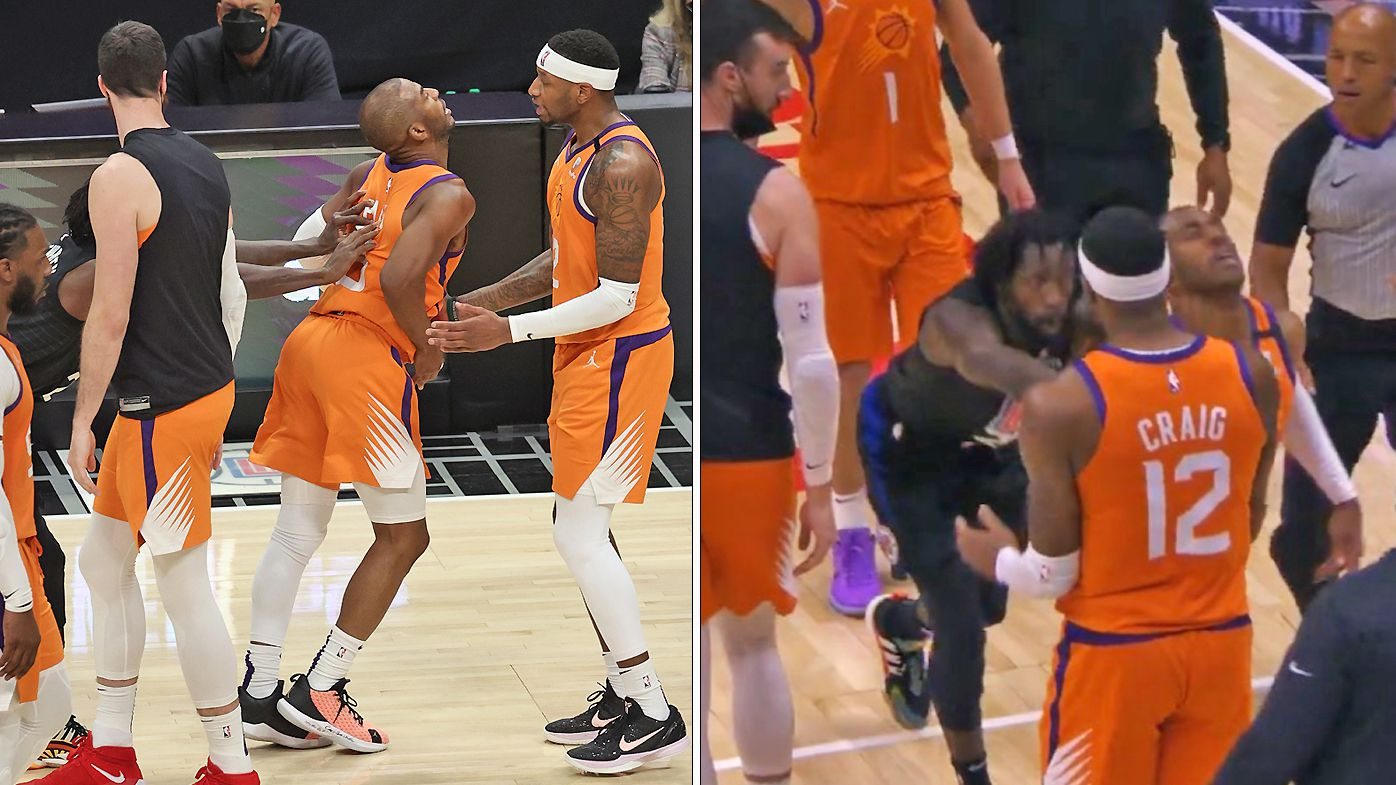 Patrick Beverley #21 of the LA Clippers is held back after pushing Chris Paul #3 of the Phoenix Suns to the ground