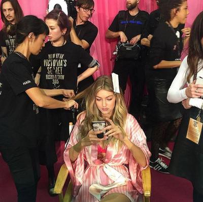 Social media sensation Gigi Hadid gets primped and primed ahead of her first ever Victoria's Secret runway show. (Instagram/@marthagraeff)