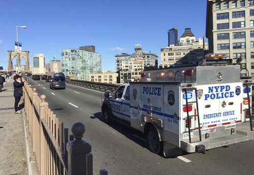 An NYPD emergency service vehicle brings up the rear of a heavily armed federal law enforcement caravan carrying Joaquin Guzman back to a lower Manhattan jail following a pretrial hearing.