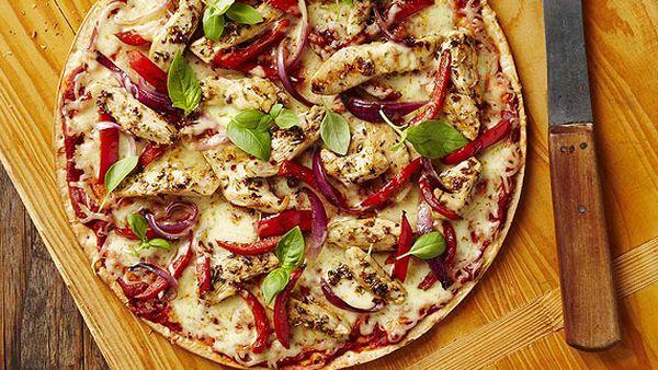 Mediterranean chicken pizza with basil
