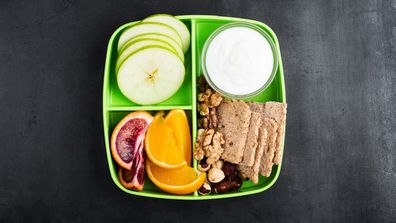 School lunch green box with oranges and crackers