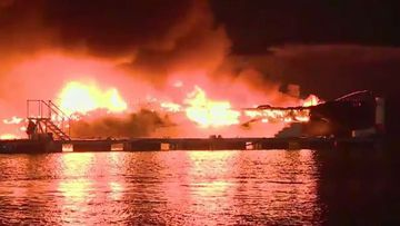 Eight yachts were destroyed in the blaze. (Supplied/ AP)