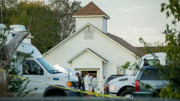 Investigators work at the scene of a mass shooting at the First Baptist Church in Sutherland Springs. (AAP)